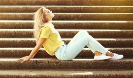 Fashion pretty young woman relaxing and enjoys sunny summer day Stock Photos