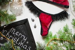 Fashion red panties and bra set as a Christmas gift on the white Stock Photo