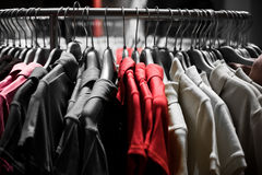 Fashion red T-shirts in colors Royalty Free Stock Photography