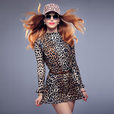Fashion Redhead Model. Stylish Mohawk hairstyle. Fashion Redhead Model Girl in Summer Leopard Outfit. Stylish Wavy hairstyle, fashion Sunglasses, Beauty Woman in royalty free stock image