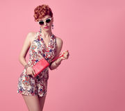 Fashion Redhead Model in Summer Jumpsuit on Pink Royalty Free Stock Photography