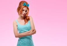 Fashion redhead model in trendy sexy dress, Pinup Royalty Free Stock Images