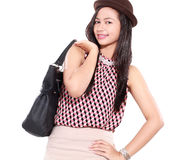 Fashion retro portrait of stylish young woman with leather bag. Isolated on white background Royalty Free Stock Image