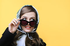 Fashion retro style portrait of young beautiful woman in sunglas Royalty Free Stock Photography