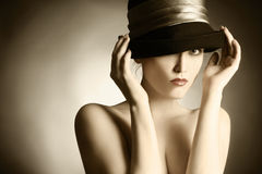 Fashion retro woman elegant hat. Fashion portrait of retro woman in elegant hat. Beautiful nude woman in black hat Stock Photography