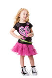 Fashion rock'n roll child. Happy smiling child girl in fashion rock and roll outfit shirt and skirt with attitude expression, isolated Stock Photos