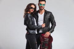 Fashion rock and roll couple standing with electric guitar Royalty Free Stock Photo
