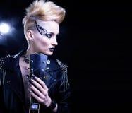 Fashion rocker style model girl portrait. Hairstyle. Punk woman makeup, hairdo and black nails. Smoky eyes Stock Photography