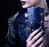Fashion Rocker Style Model Girl Portrait. Hairstyle. Punk Woman Makeup, Hairdo and black Nails. Smoky Eyes Royalty Free Stock Photography