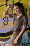 Fashion runway model posing at locations with graffiti on the walls Stock Image