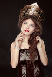 Fashion Russian girl model in exclusive design clothes on manner. S old-Slavic. Close-up portrait Stock Photos