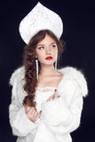Fashion Russian girl model in Slavic exclusive design clothes on. Manners old-Slavic. Close-up portrait Royalty Free Stock Photography