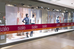 Fashion Sale. Fashion mannequin display and indication of sale at department store Royalty Free Stock Photography