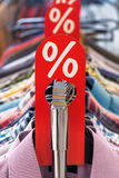 Fashion sale rack with red label shirts and hangers Royalty Free Stock Photography