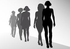 Fashion on scene. Vector drawing fashion models on scene. Silhouettes womens Stock Image