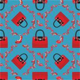 Fashion seamless pattern.High heel shoes and handbags. Fashion seamless pattern.Female's colored red high heel shoes with handbags .Bright summer composition Royalty Free Stock Photography