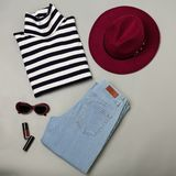 Fashion set of blue jeans, striped sweater, burgundy hat and sun. Glsses. Flat lay. Top view Royalty Free Stock Photo