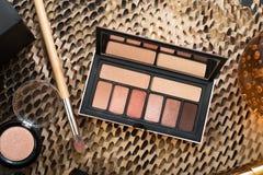 Fashion set of new cosmetics eyeshadows palettes with brushes. close up stock photography