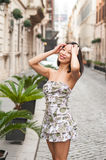 Fashion sexy asian woman relaxed posing on european street Stock Image
