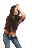 Fashion brunette girl in jeans and shirt Royalty Free Stock Image