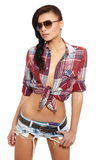 Fashion brunette girl in jeans and shirt Stock Image