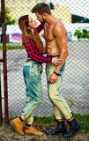 Fashion sexy couple in the street in casual hipster cloth. High fashion look.beautiful couple sexy stylish blond young women model with bright makeup with Royalty Free Stock Photo