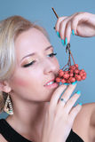 Fashion girl with red berries Stock Image