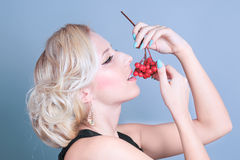 Fashion sexy girl with red berries Royalty Free Stock Image