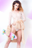 Fashion sexy model in fur coat and lingerie Stock Images