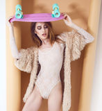 Fashion sexy model in fur coat and lingerie Royalty Free Stock Photography