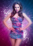 Fashion sexy model in mini skirt over creative background Stock Images