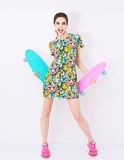 Fashion sexy vogue model in colorful dress with. Bright ornament promote longboards in studio Royalty Free Stock Photo