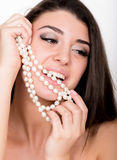 Fashion sexy young woman with pearls jewellery Stock Photos