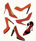 Fashion Shoes. Six different red and black shoes over one piece patterened background Royalty Free Stock Photos
