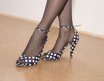 Fashion shoes. Great old looking fashion shoes on good looking legs Royalty Free Stock Images