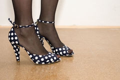 Fashion shoes. Great old looking fashion shoes on good looking legs Royalty Free Stock Photo
