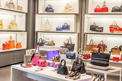 Fashion shoes and bags. In a shop Stock Photos
