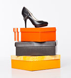 Fashion shoes on the boxes Royalty Free Stock Photos