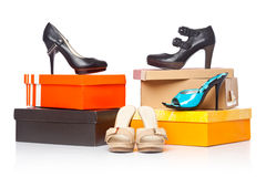 Fashion shoes on the boxes Stock Photography