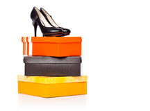 Fashion shoes on the boxes Stock Photos