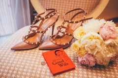 Fashion shoes, bridal bouquet and book Stock Photo