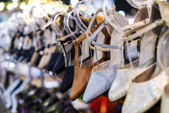 Fashion shoes on shelves in the shop. For design work Royalty Free Stock Images