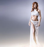 Fashion shoot of an Aphrodite styled young woman Royalty Free Stock Images
