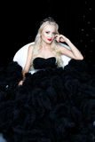 Fashion shoot of beautiful blond woman in a long black dress Stock Photos