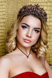 Fashion shoot of beauty young queen long blond hair crown on her head Royalty Free Stock Photo