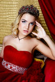 Fashion shoot of beauty young queen long blond hair crown on her head Stock Images