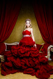 Fashion shoot of beauty young queen long blond hair crown on her head Royalty Free Stock Image