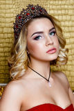 Fashion shoot of beauty young queen long blond hair crown on her head Stock Photos