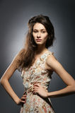Fashion shoot of a brunette in a summer dress Stock Image