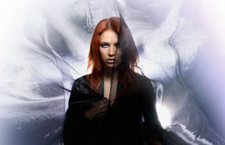 Fashion shoot of a mystique redhead woman Royalty Free Stock Photography